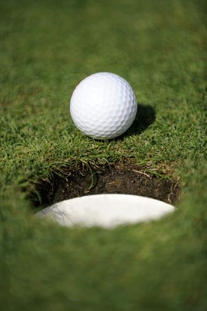 golfball close to the hole Stock Photo