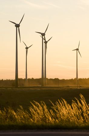 wind farm turbines generators rows at dusk Stock Photo
