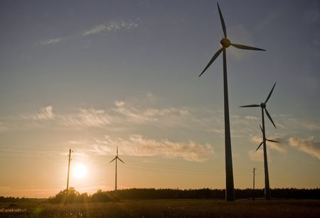 wind farm turbine generators rows at dusk Stock Photo