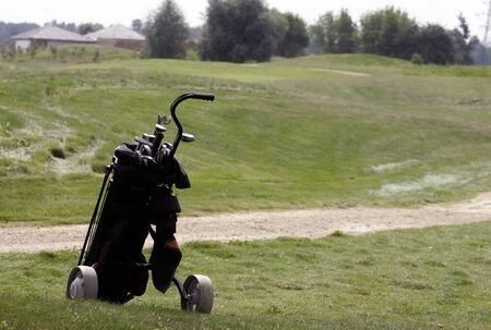 A set up new golf clubs on a beautiful golf course   Stock Photo