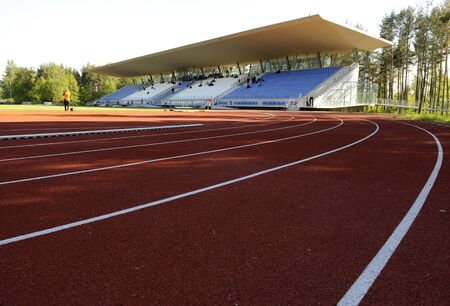 Athletics stadium with track and soccer field Stock Photo