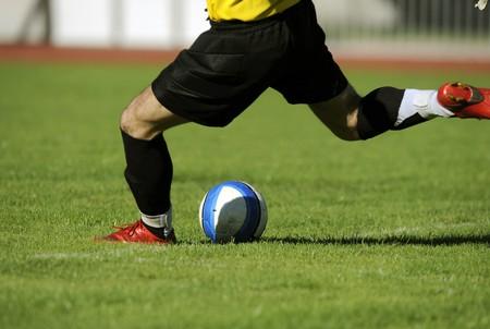 soccer goalkeeper: Soccer goalkeeper makes a free kick