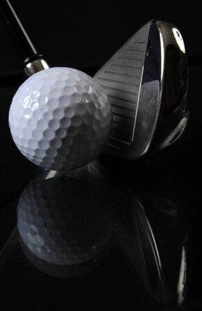 Golf club with ball in the black background