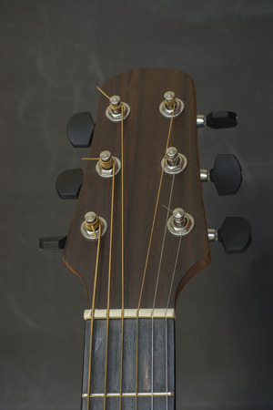 fret: Headstock,fret bord,frets,tuners of guitar acoustic.