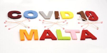 CONCEPT COVID-19 PENDAMIC COVID-19 Malta. Colourful felt Text .