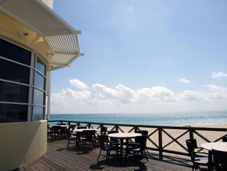 oceanfront: Tables and chairs setup for breakfast and lunch at a beach front restaurant - Ocean View