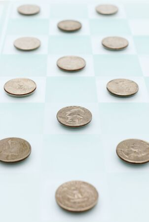 25 cents: Checkers with Money Stock Photo
