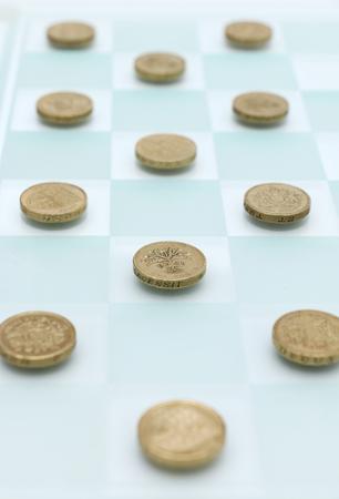 quid: Checkers with Money Stock Photo