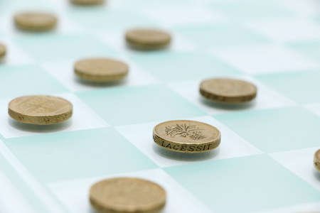 checkers: Checkers with Money Stock Photo