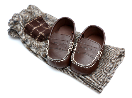 brown clothes: Baby Clothes and Shoes Stock Photo