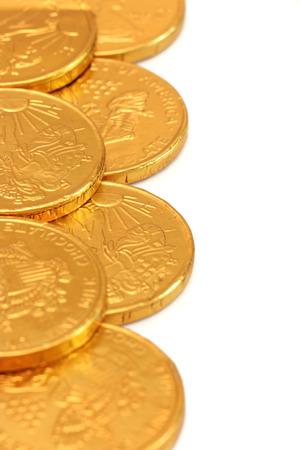 aguila real: Oro del chocolate Monedas Foto de archivo