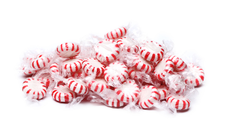 peppermint candy: A pile of peppermint candies on a white background