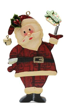 clause: A wooden toy Santa Clause isolated on a white background