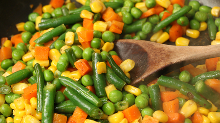 skillet: Mixed vegetables cooking together in a skillet Stock Photo
