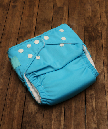nappies: Single cloth diaper on a wooden background