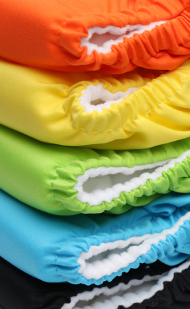 nappies: Stack of five colorful diapers in a stack