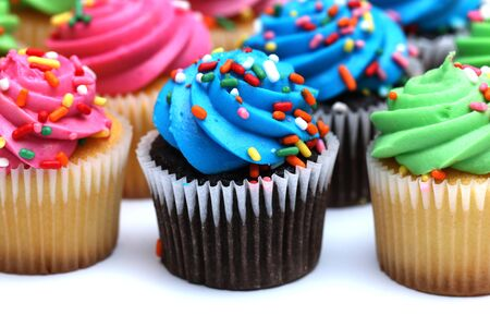 cupcakes: Multicolored Cupcakes Isolated on a White Background