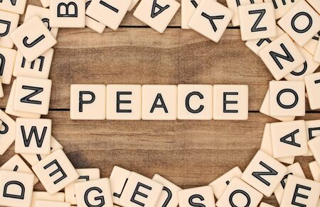 spelled: Peace spelled out in tan tile letters