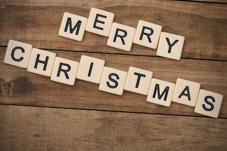 spelled: Merry Christmas spelled out in tan tile letters