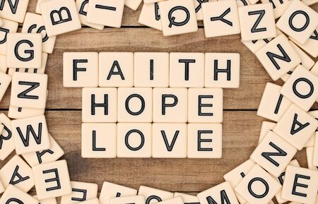 spelled: Faith, Hope and Love spelled out in block letters