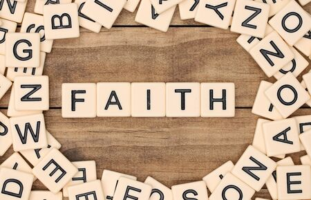 spelled: Faith spelled out in tan tile letters