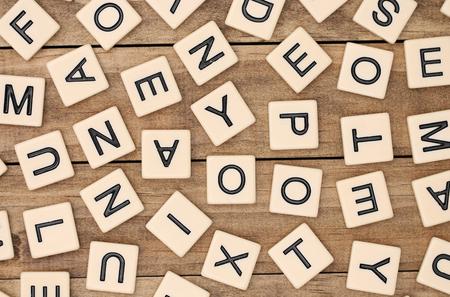 A background of various tan letter tiles Standard-Bild