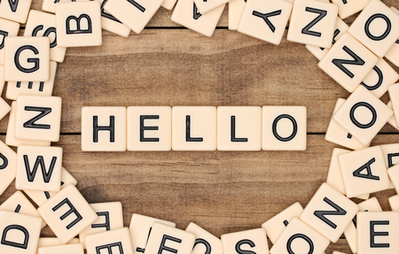 spelled: Hello spelled out in tan tile letters Stock Photo