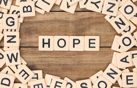 spelled: Hope spelled out in tan tile letters