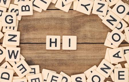 spelled: Hi spelled out in tan tile letters