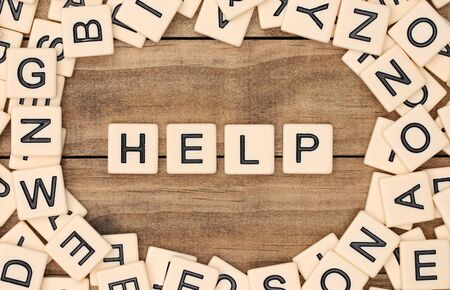 spelled: Help spelled out in tan tile letters