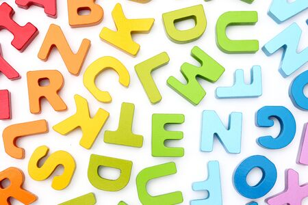 Rainbow Alphabet scattered on a white background Stockfoto