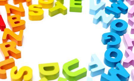 alphabet blocks: A border of rainbow colored wooden alphabet blocks