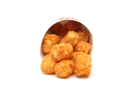 tots: Tater tots in a containter on a white background Stock Photo