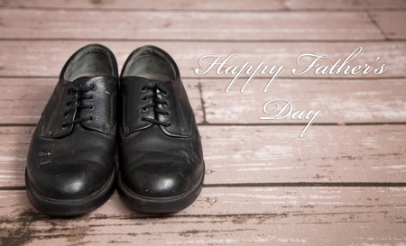 Old Black Dress Shoes on a Wooden Floor Stock Photo
