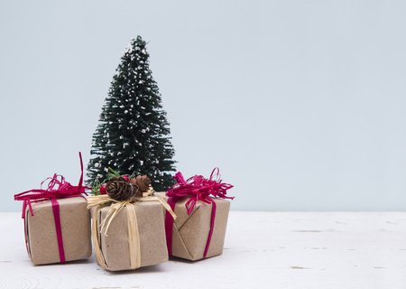 Minimalistic Christmas Scene with a Blue Background on a Distressed Wooden Table Stock Photo