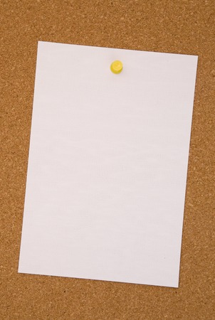 Blank White Paper on a Cork Board Stock Photo