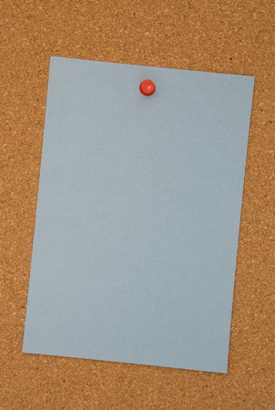 Blank Blue Paper on a Cork Board