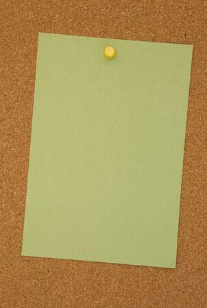 Blank Green Paper on a Cork Board