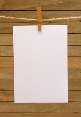 Background of Hanging Paper on a Wooden Background 版權商用圖片