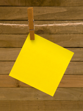 Background of Hanging Paper on a Wooden Background Stock Photo - 93834204