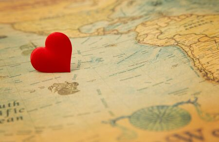 A love heart on an old vintage map - Do you love the world?