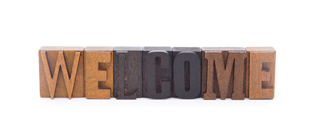 WELCOME spelled in wooden block letters - Use in your literatue to make someone feel a part of the group  Stock Photo