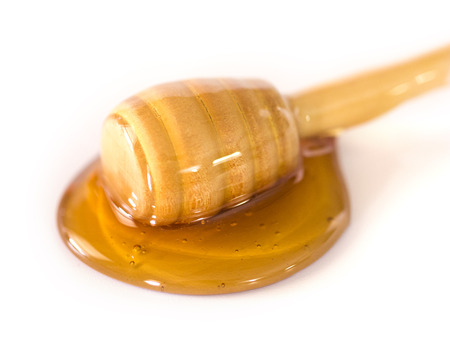 Honey with a Honey Spoon on a White Background Stockfoto