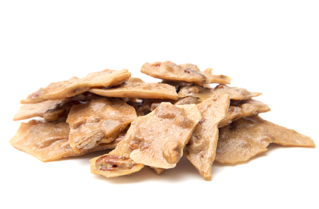 Homemade Pecan Brittle on a White Background