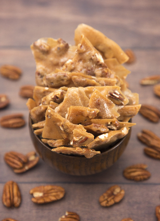 Homemade Pecan Brittle on a Wooden Table