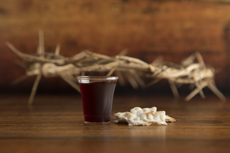 Christian Communion on a Wooden Table Archivio Fotografico