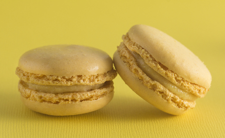 Yellow French Macarons on a Yellow Background
