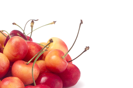 Sweet and Beautiful Red and  Yellow Golden Cherries on a White Background