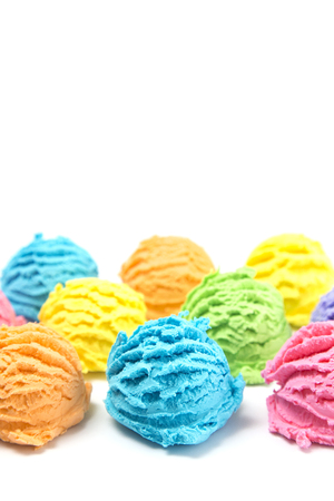 Scoops of Rainbow Ice Cream on a White Table