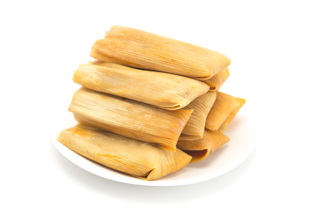 Homemade Wrapped Tamales Isolated on a White Background